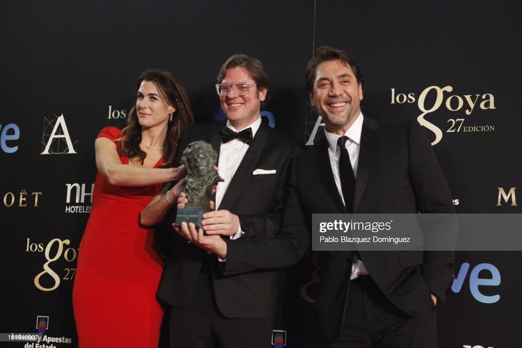 Lilly Hartley, Alvaro Longoria and Javier Bardem hold his award for 'Best Documentary Film' in the film 'Hijos de las nubes' during the 2013 edition of the 'Goya Cinema Awards' ceremony at Centro de Congresos Principe Felipe on February 17, 2013 in Madrid, Spain.
