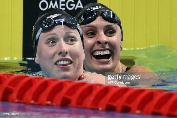 US Lilly King and US Katie Meili react after competing in the women's 100m breaststroke final during the swimming competition at the 2017 FINA World...