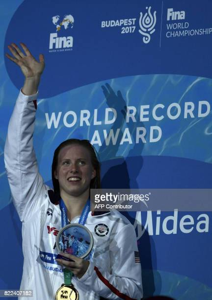 US Lilly King celebrates on the podium after the women's 100m breaststroke final during the swimming competition at the 2017 FINA World Championships...