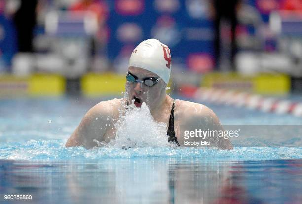 Lilly King competes in the women's 100 meter breaststroke during the fourth day of the TYR Pro Swim Series at Indiana University Natatorium on May 19...