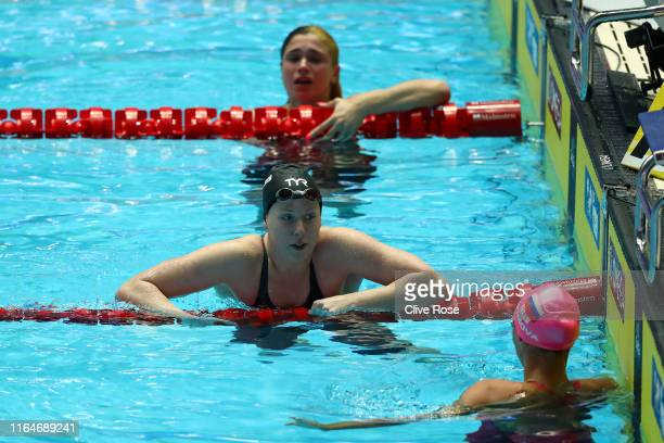 Lilly King of the United States and Yulia Efimova of Russia celebrate winning the gold and bronze respectively after competing in the Women's 50m...