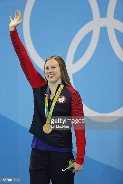 Lilly King of United States poses with her gold medal from the Women's 100m Breaststroke on Day 3 of the Rio 2016 Olympic Games at the Olympic...