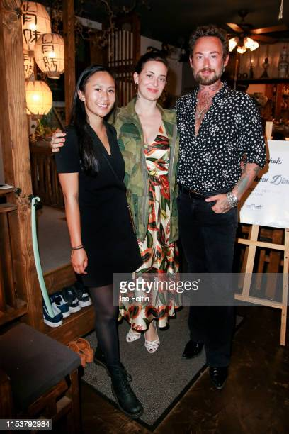 Lilly Linh Le with fashion designer Lena Hoschek and fashion designer Marcel Ostertag during the Umami after show dinner on July 4 2019 in Berlin...