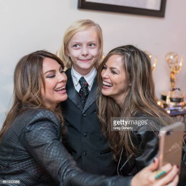 Lilly Melgar Christian Ganiere and Terri Ivens take a selfie at The Bay Ugly Sweater And Secret Santa Christmas Party at Private Residence on...