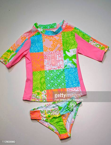 Lilly Pulitzer multicolored jubilee patch with bikini bottom and tankini top $68 matching rash guard $74 all from Lilly Pulitzer
