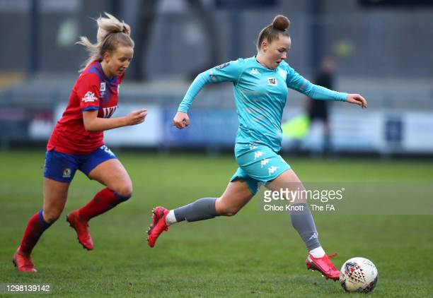 Lilly Pursey of London City Lionesses looks to break past Charlotte Newsham of Blackburn Ladies during the Barclays FA Women's Championship match...