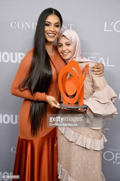 Lilly Singh and Muzoon Almellehan pose with an award backstage at the Glamour's 2017 Women of The Year Awards at Kings Theatre on November 13 2017 in...