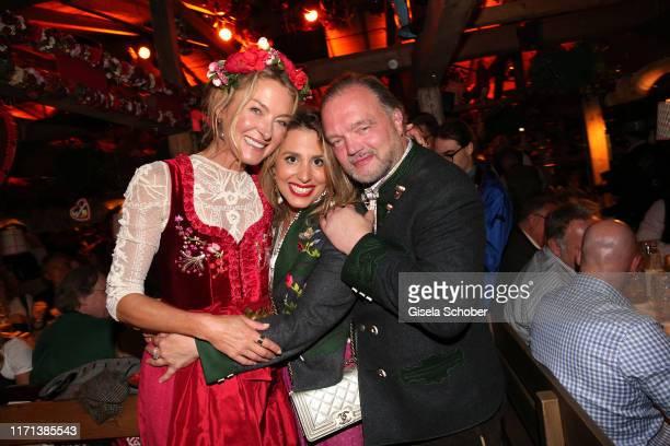 Lilly zu SaynWittgensteinBerleburg and Fuerst Alexander zu SchaumburgLippe and his partner Mahkameh Navabiat during the Oktoberfest 2019 at...
