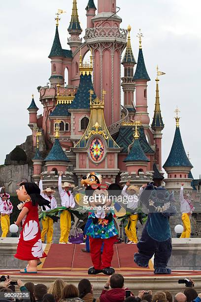 Lilo, Goofy, Mickey, Stitch and Dancers perform during a show in the front of the Cinderella Castle during the New Generation Year Launch at...