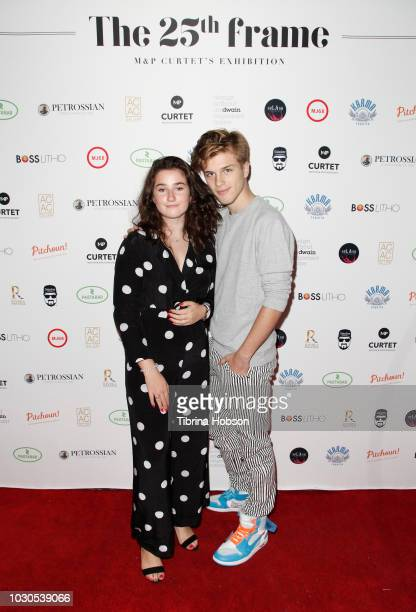 Lilou Curtet and Alex Lange attend The 25th Frame solo exhibition by Patrick Curtet on September 8 2018 in Los Angeles California
