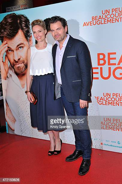 Lilou Fogli and Clovis Cornillac attend the 'Un Peu Beaucoup Aveuglement' Paris Premiere at Cinema Gaumont Capucines on May 4 2015 in Paris France
