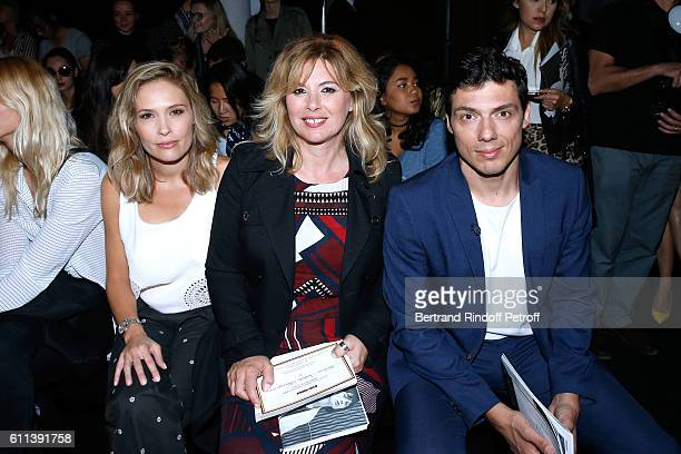Lilou Fogli Nathalie Baumgartner and Taig Khris attend the Alexis Mabille show as part of the Paris Fashion Week Womenswear Spring/Summer 2017 on...