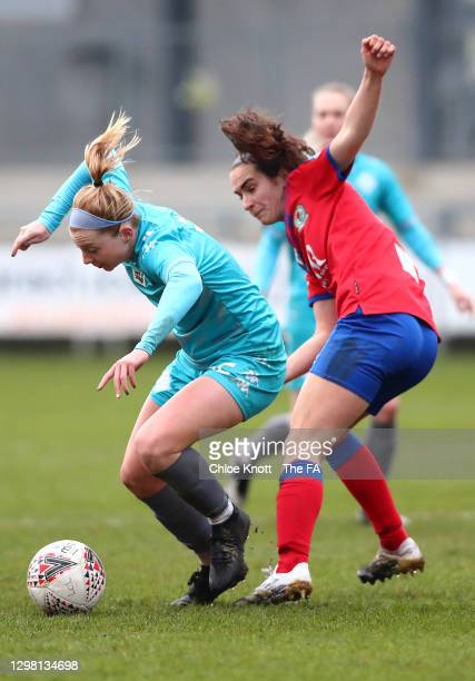 Lily Agg of London City Lionesses is challenged by Natasha Fenton of Blackburn Ladies during the Barclays FA Women's Championship match between...