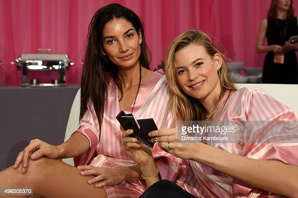 Lily Aldridge and Behati Prinsloo are seen backstage before the 2015 Victoria's Secret Fashion Show at Lexington Avenue Armory on November 10 2015 in...