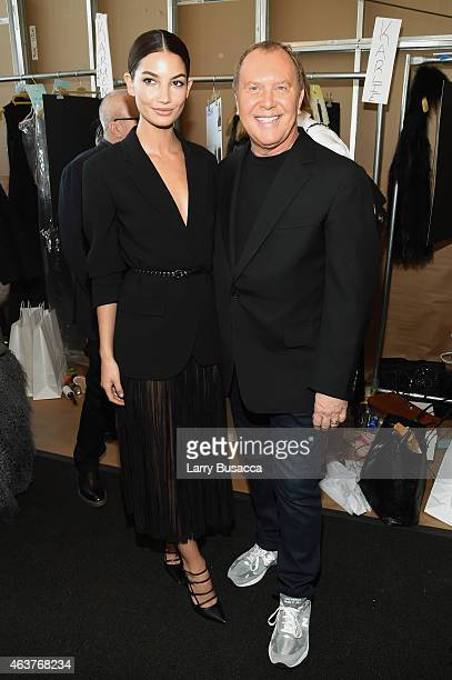 Lily Aldridge and designer Michael Kors pose backstage at the Michael Kors fashion show during MercedesBenz Fashion Week Fall 2015 at Spring Studios...