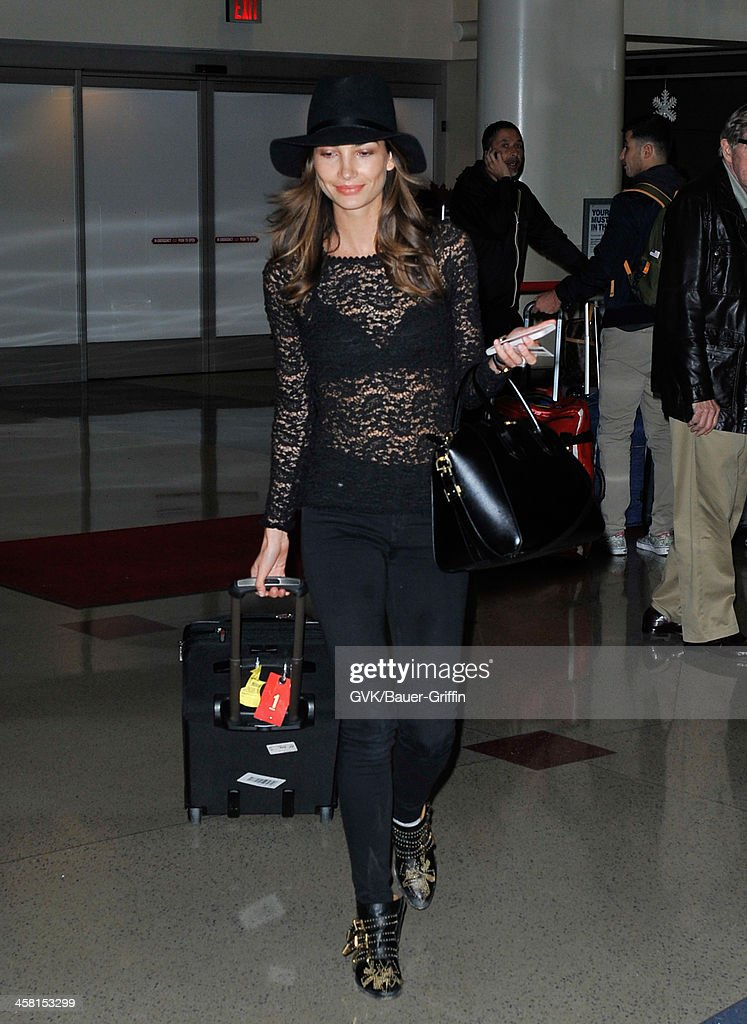 Lily Aldridge is seen at LAX airport on December 19, 2013 in Los Angeles, California.