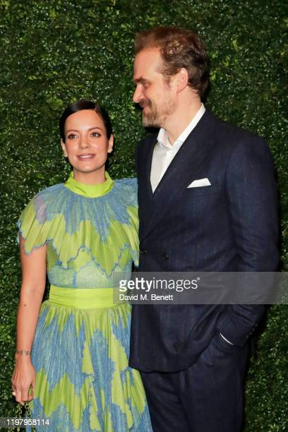 Lily Allen and David Harbour arrive at the Charles Finch CHANEL PreBAFTA Party at 5 Hertford Street on February 1 2020 in London England