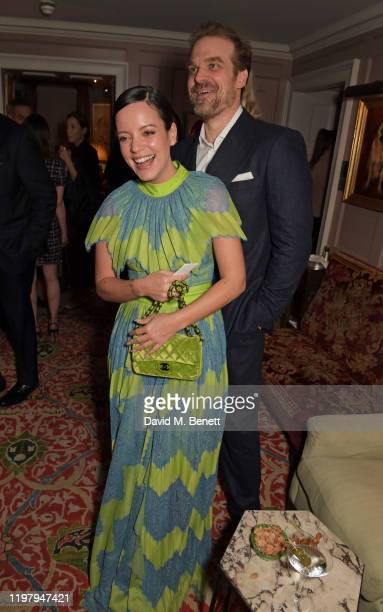 Lily Allen and David Harbour attend the Charles Finch CHANEL PreBAFTA Party at 5 Hertford Street on February 1 2020 in London England
