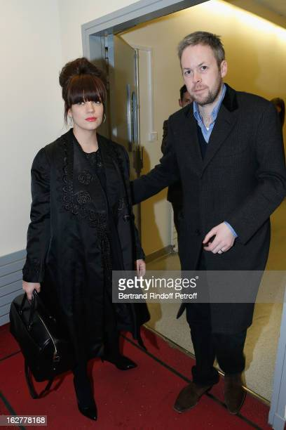 Lily Allen and husband Sam Cooper pose backstage following the Etam Live Show Lingerie at Bourse du Commerce on February 26 2013 in Paris France