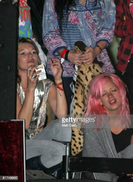 Lily Allen and Kate Moss watch The Kills play on the John Peel Stage at the Glastonbury Festival on June 27 2008 in Glastonbury Somerset England The...