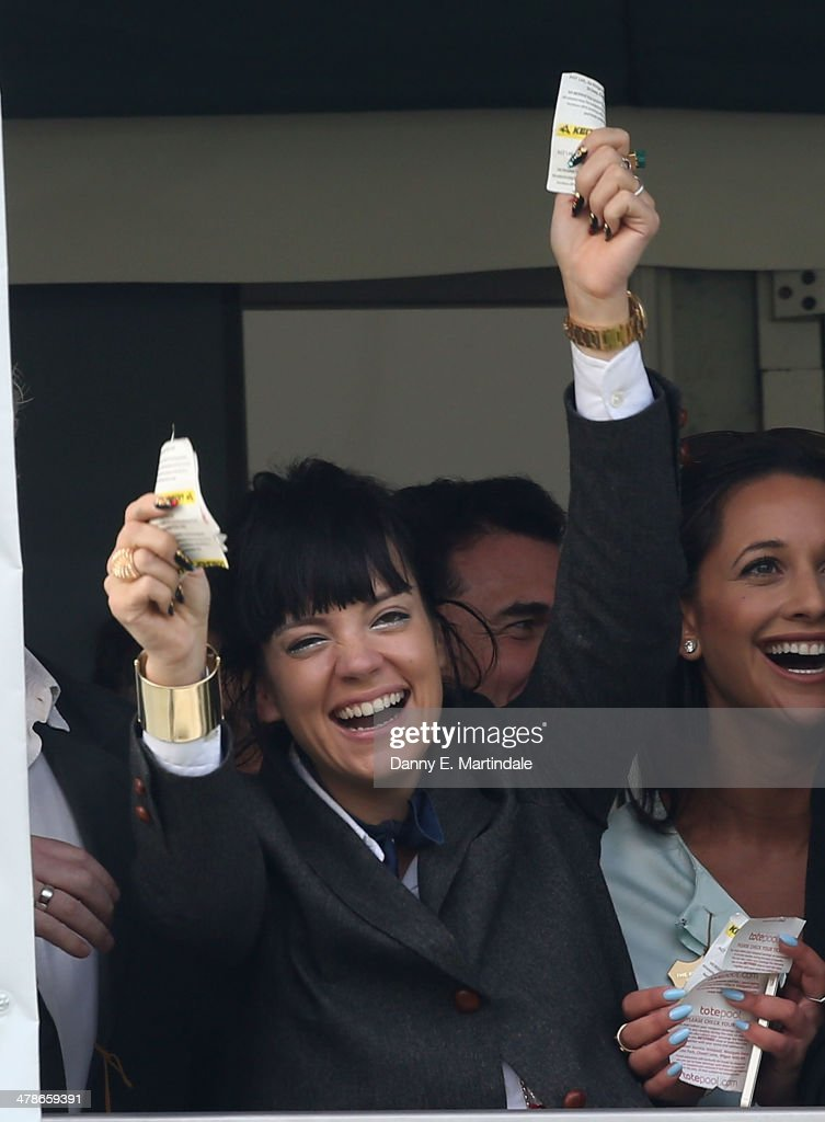 Lily Allen celebrates watching her horse win the Cheltenham Gold Cup Steeple Chase on day 4 of The Cheltenham Festival at Cheltenham Racecourse on March 14, 2014 in Cheltenham, England.