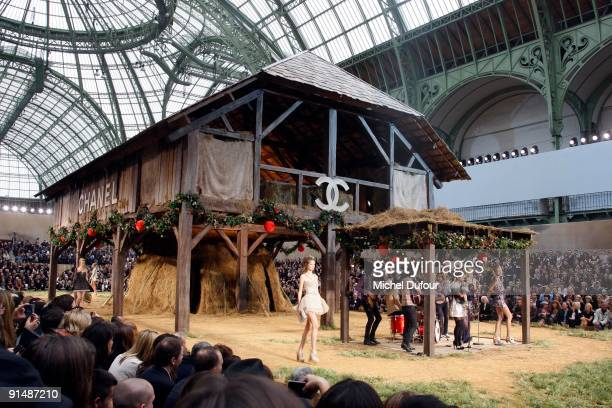 Lily Allen performs during the Chanel Pret a Porter show as part of the Paris Womenswear Fashion Week Spring/Summer 2010 at Grand Palais on October 6...