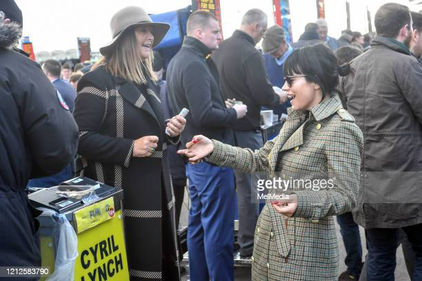 Lily Allen seen collecting her winnings as she attends Day 4 of the Cheltenham Festival 2020 at Cheltenham Racecourse on March 13 2020 in Cheltenham...