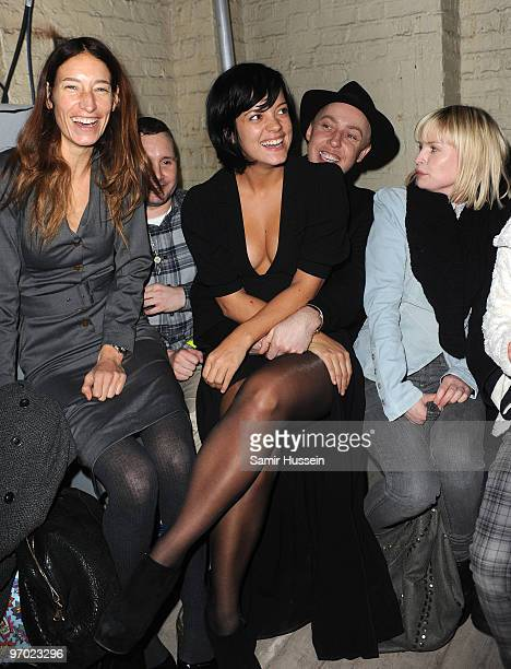 Lily Allen sits on the knee of hairdresser James Brown as they attend the James Small London Fashion Week Autumn/Winter 2010 show in the Vaults on...