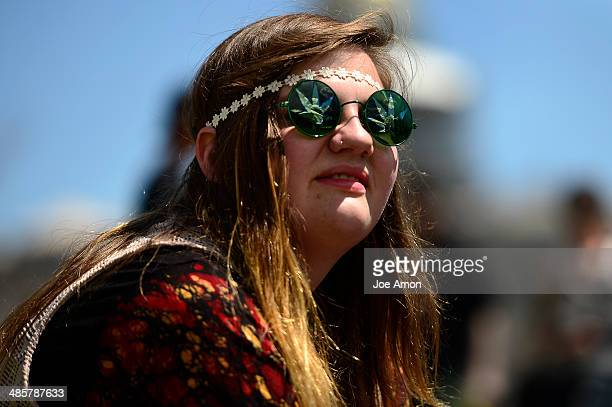 Lily Berryman 18 of Fort Collins has clouds in her sunglasses at the Denver 420 Rally in Civic Center Park April 20 2014 Denver CO