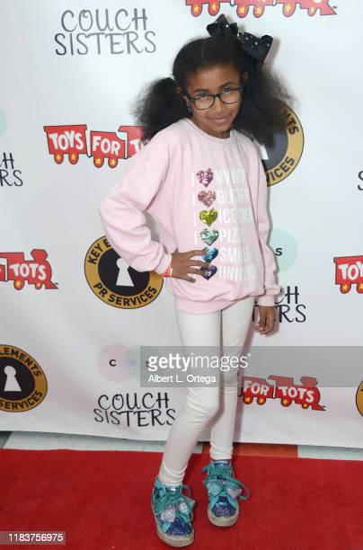 Lily Billington attends The Couch Sisters 1st Annual Toys For Tots Toy Drive held onNovember 20 2019 in Glendale California
