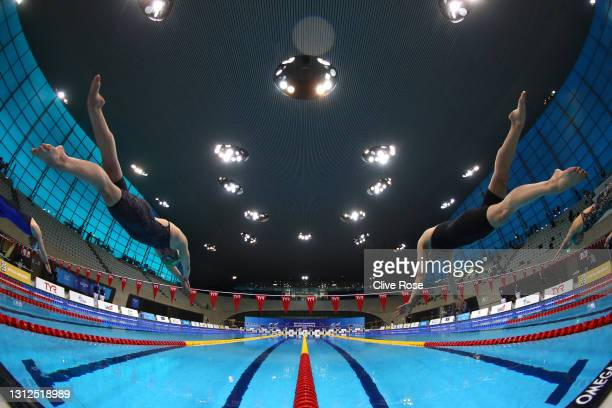 Lily Booker and Aimee Willmott of Great Britain start the Women's 400m Individual Medley Final on day one of the British Swimming Selection Trials...