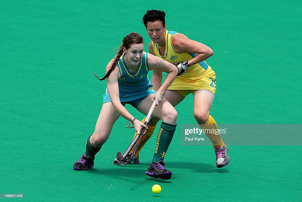 Lily Brazel of the Jillaroos and Teneal Attard of the Hockeyroos contest for the ball in the gold medal match between the Australian Hockeyroos and the Australian Jillaroos during day four of the 2012 International Super Series at Perth Hockey Stadium on November 25, 2012 in Perth, Australia.