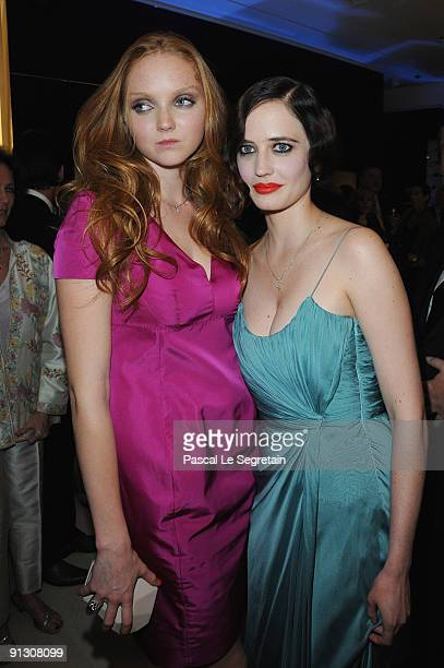 Lily Cole and Eva Green attend the Montblanc Paris Flagship Boutique Launch Inauguration Cocktail party on October 1 2009 in Paris France