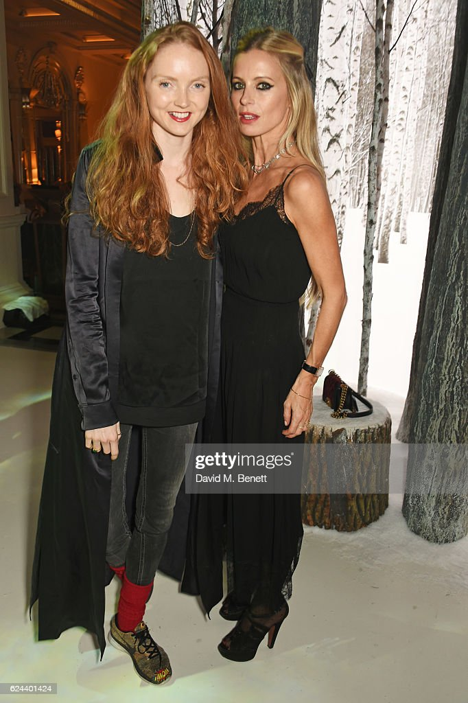 Lily Cole (L) and Laura Bailey attend Claridge's Christmas Tree 2016 Party, with tree designed by Sir Jony Ive and Marc Newson, at Claridge's Hotel on November 19, 2016 in London, England.