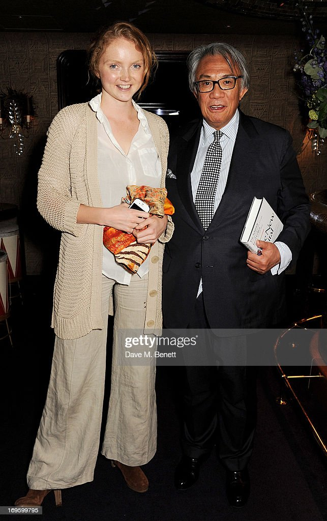 Lily Cole (L) and Sir David Tang attend the launch of 'The New Digital Age: Reshaping The Future Of People, Nations and Business' by Eric Schmidt and Jared Cohen, hosted by Jamie Reuben, at Loulou's on May 28, 2013 in London, England.