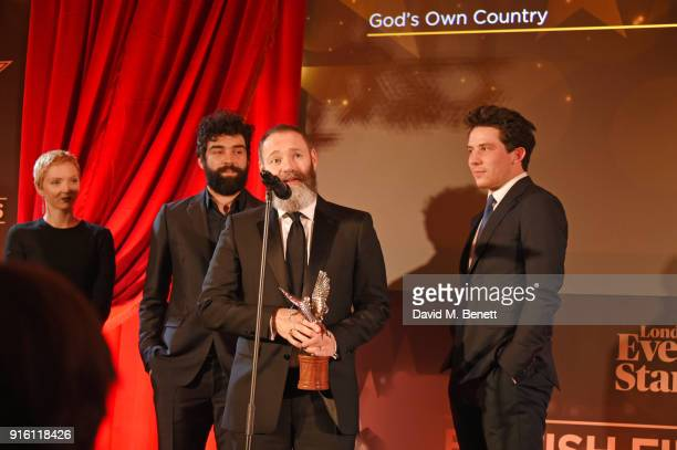 Lily Cole looks on as Alec Secareanu Francis Lee and Josh O'Connor accept the Everyman Award for Best Film for 'God's Own Country' at the London...