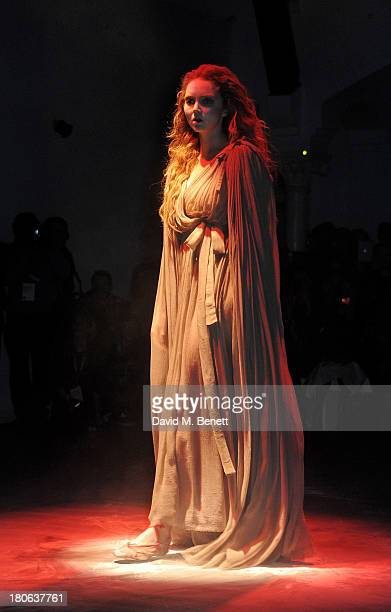 Lily Cole performs on the runway at the Vivienne Westwood Red Label show during London Fashion Week SS14 on September 15 2013 in London England
