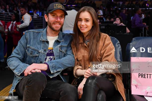 Lily Collins and Charlie McDowell attend a basketball game between the Los Angeles Lakers and the Cleveland Cavaliers at Staples Center on January...