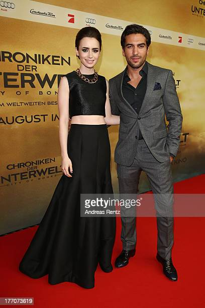 Lily Collins and Elyas M'Barek arrive for the 'The Mortal Instruments City of Bones' Germany premiere at Sony Centre on August 20 2013 in Berlin...