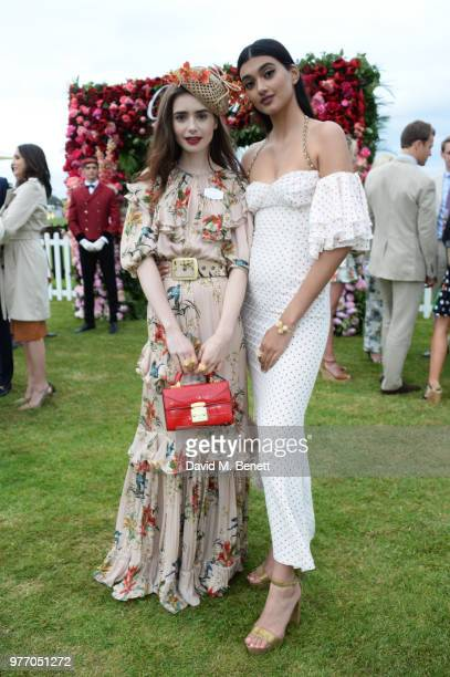 Lily Collins and Neelam Gill attend the Cartier Queen's Cup Polo Final at Guards Polo Club on June 17 2018 in Egham England