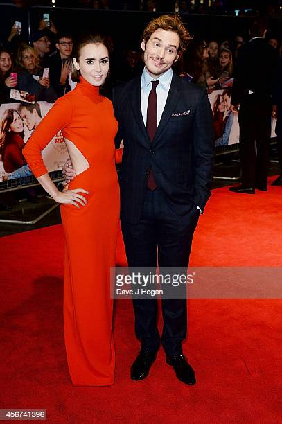 """Lily Collins and Sam Claflin attend the World Premiere of """"Love, Rosie"""" at Odeon West End on October 6, 2014 in London, England."""