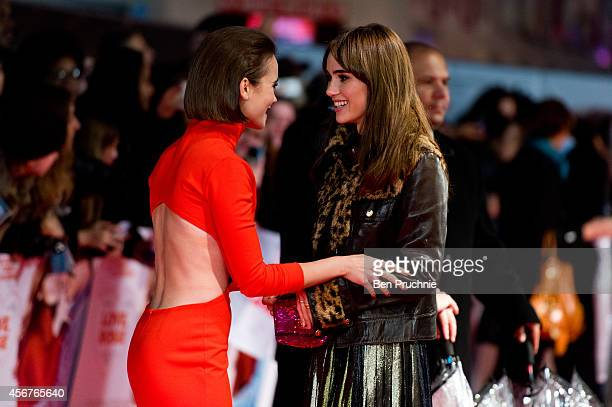 """Lily Collins and Suki Waterhouse attends the World Premiere of """"Love, Rosie"""" at Odeon West End on October 6, 2014 in London, England."""