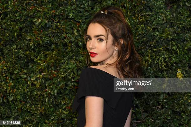 Lily Collins attends Charles Finch and CHANEL PreOscar Awards Dinner at Madeo Restaurant on February 25 2017 in Los Angeles California