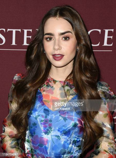 Lily Collins attends Les Misérables Photo Call at Linwood Dunn Theater on June 08 2019 in Los Angeles California