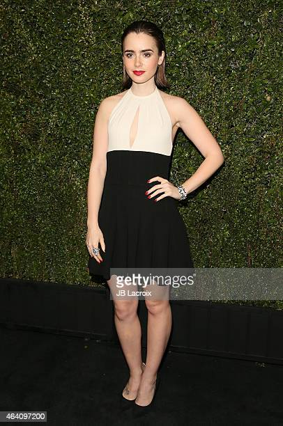Lily Collins attends the Chanel And Charles Finch PreOscar Dinner at Madeo Restaurant on February 21 2015 in West Hollywood California