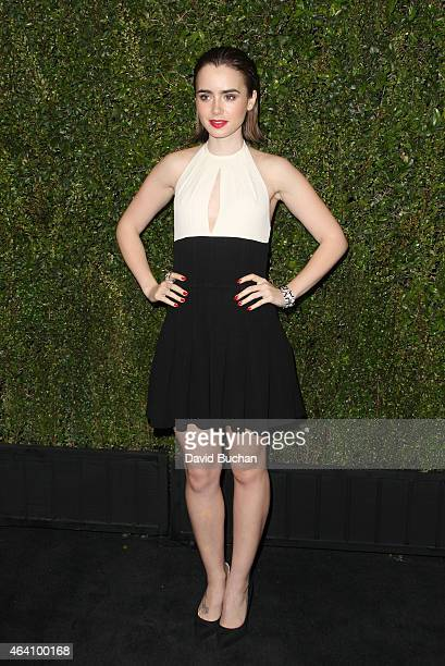 Lily Collins attends the Chanel and Charles Finch Pre-Oscar Dinner at Madeo Restaurant on February 21, 2015 in Los Angeles, California.