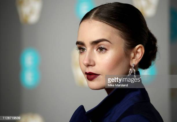 Lily Collins attends the EE British Academy Film Awards at Royal Albert Hall on February 10 2019 in London England