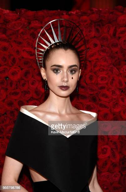 Lily Collins attends the Heavenly Bodies Fashion The Catholic Imagination Costume Institute Gala at The Metropolitan Museum of Art on May 7 2018 in...