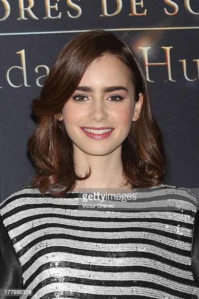 Lily Collins attends The Mortal Instruments City of Bones Mexico City photocall at St Regis Hotel on August 26 2013 in Mexico City Mexico