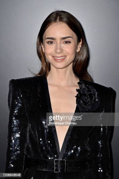 Lily Collins attends the Saint Laurent show as part of the Paris Fashion Week Womenswear Fall/Winter 2020/2021 on February 25 2020 in Paris France
